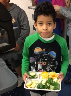 Child holding salad tray