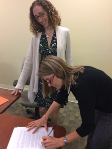 Joanne of RFFK signing agreement